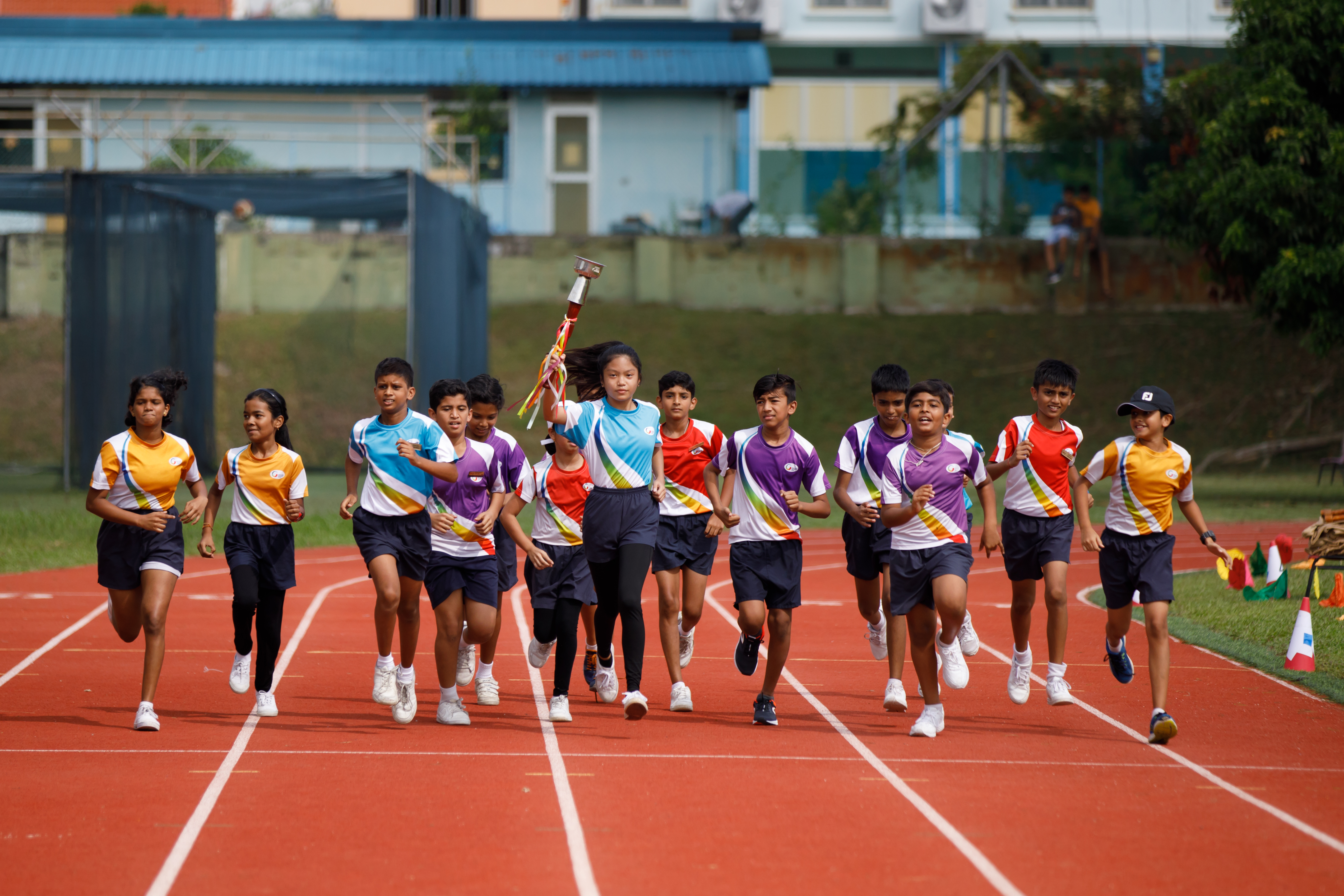 sports day annual games giis begin let balestier students school heading