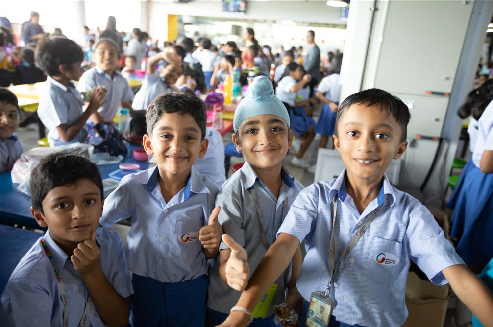 Primary students show a thumbs up at the GIIS SMART Campus