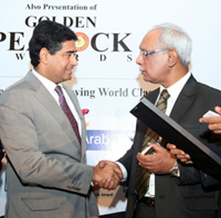 Mr Kaustubh Bodhankar being congratulated by H. E. Hon. Sayyad Abd–Al-Cader Sayed–Hossen, Minister of Industry, Commerce and Consumer Protection, Govt. of Mauritius